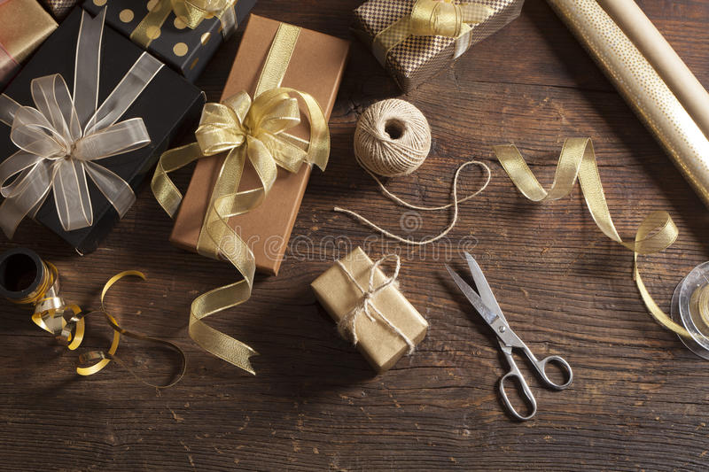 Gift boxes on wooden background. Gift boxes on thr wooden background stock image
