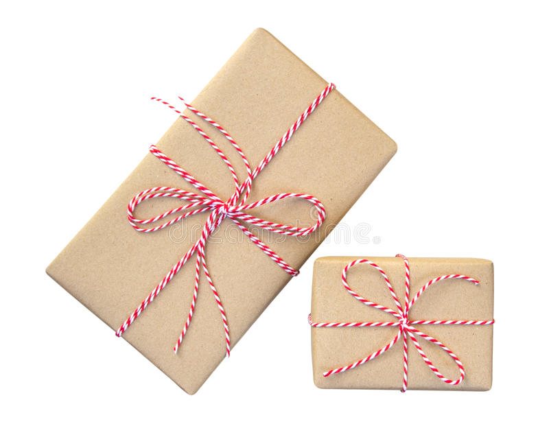 Gift boxes wrapped in brown recycled paper with red and white rope top view isolated on white background, clipping path included royalty free stock image
