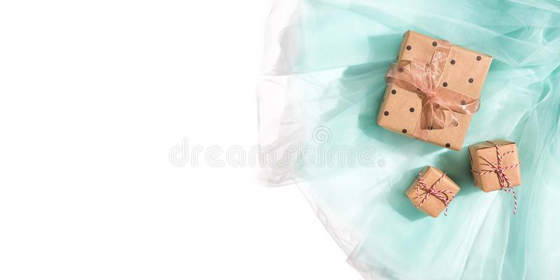 Gift boxes wrapped kraft brown paper on turquoise stock photography