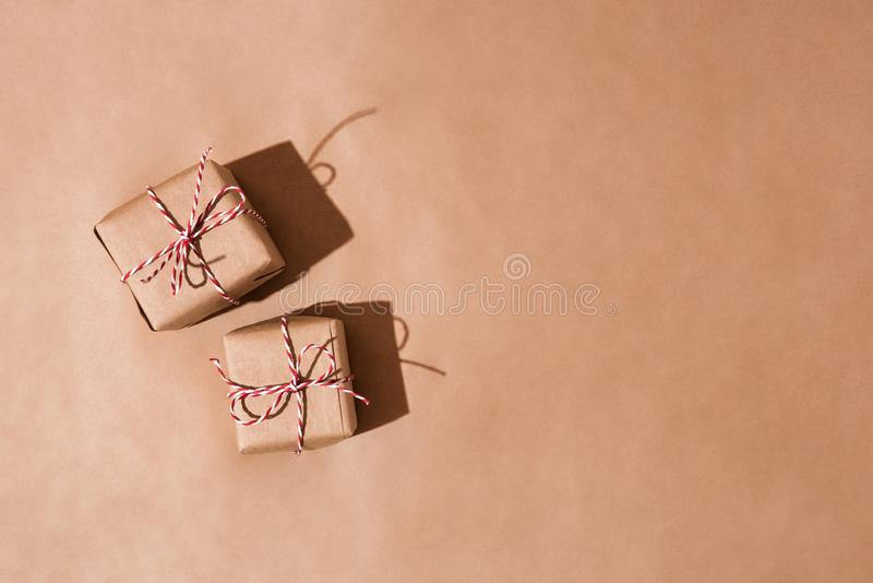 Gift boxes wrapped in a recycled craft paper royalty free stock images