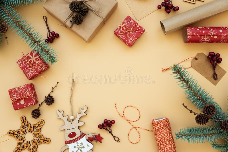 Gift boxes wrapped in red and craft paper and the contents of a workspace composed. Flat lay. Christmasr gift packing. Christmas. Gift boxes wrapped in red and royalty free stock photography