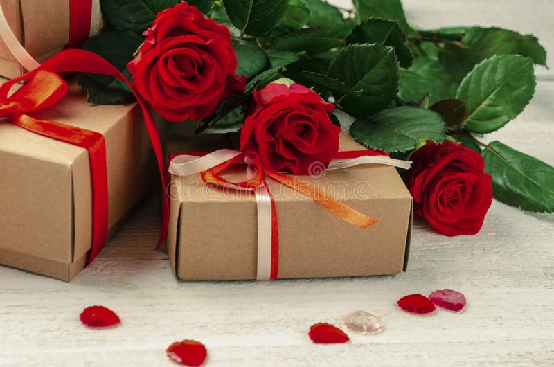 Gift boxes, background,roses, Valentine`s, Mother Day,.decorative hearts, 8 march royalty free stock images