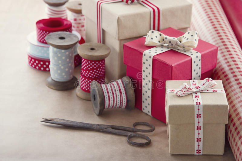Gift boxes and wrapping paper rolls royalty free stock image