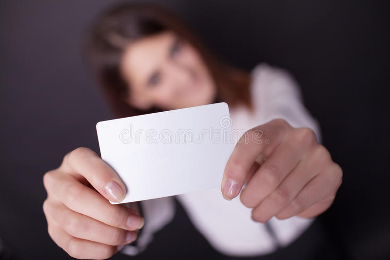 Gift card. Excited woman showing empty blank paper card sign wit. H copy space for text royalty free stock image