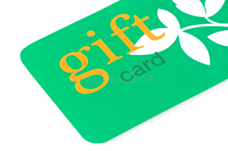 Gift Card Green. Green gift card with orange text and white leaves, great for environmentally friendly giving stock images