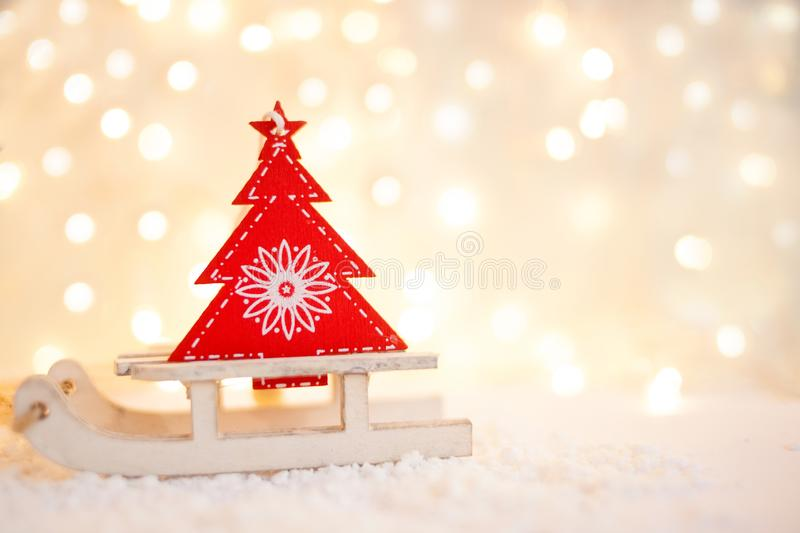 Gift card with a new year and christmas with a picture of a snowman with a sleigh against a backdrop of glowing garlands.  stock photos