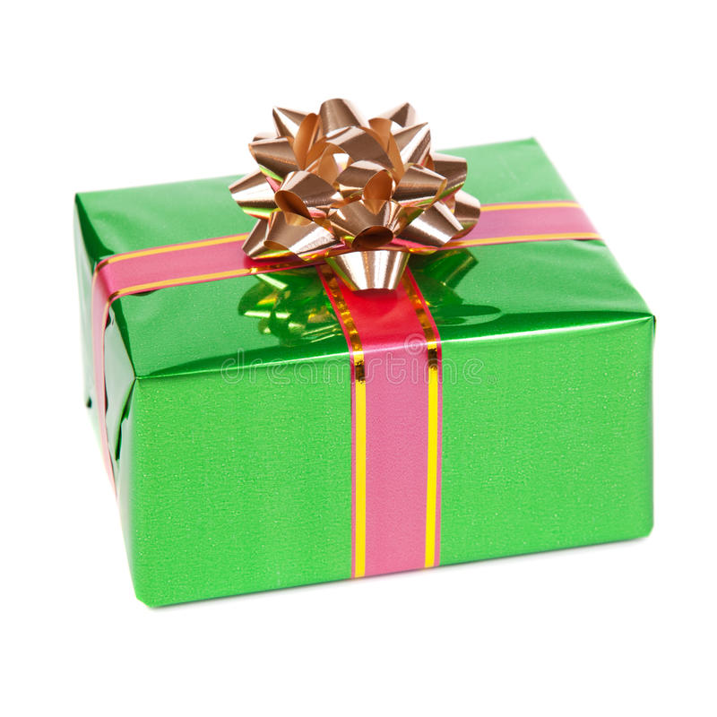 Gift in colorful package with bows royalty free stock image