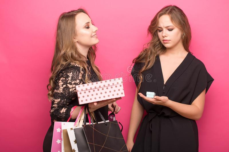 Gift comparison - loser and the winner. small and big gift boxes royalty free stock photos