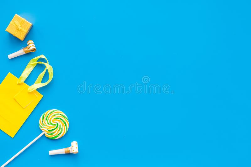 Gift concept. Sweets, paper bag for gift on blue background top view mock up royalty free stock image