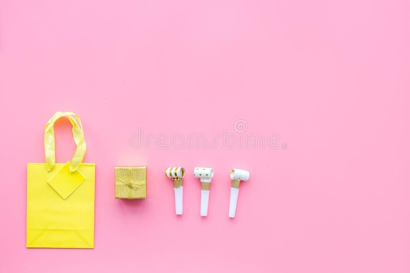 Gift concept. Sweets, paper bag for gift on pink background top view mock up royalty free stock photos