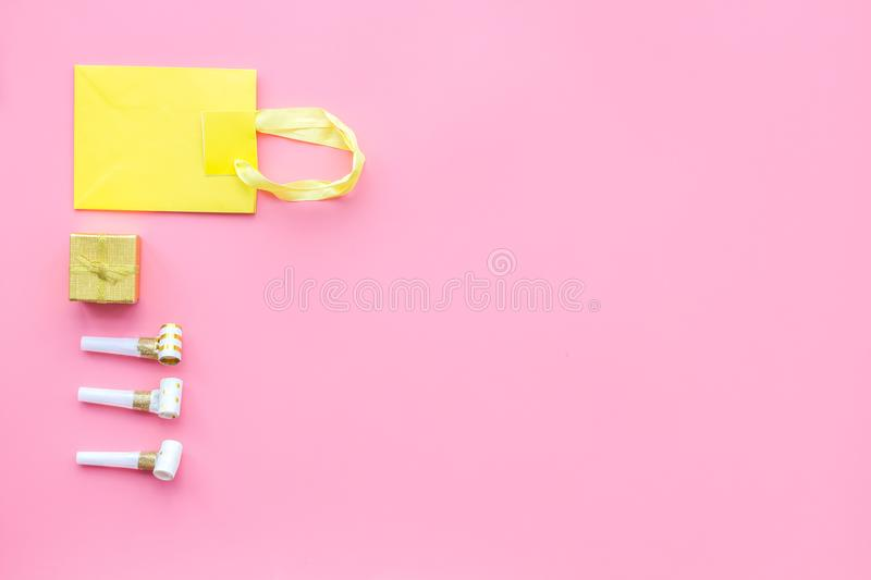 Gift concept. Sweets, paper bag for gift on pink background top view mock up stock images
