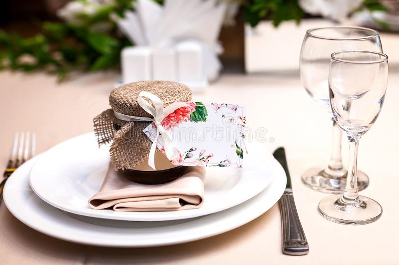 Gift confiture on a wedding party table stock photos