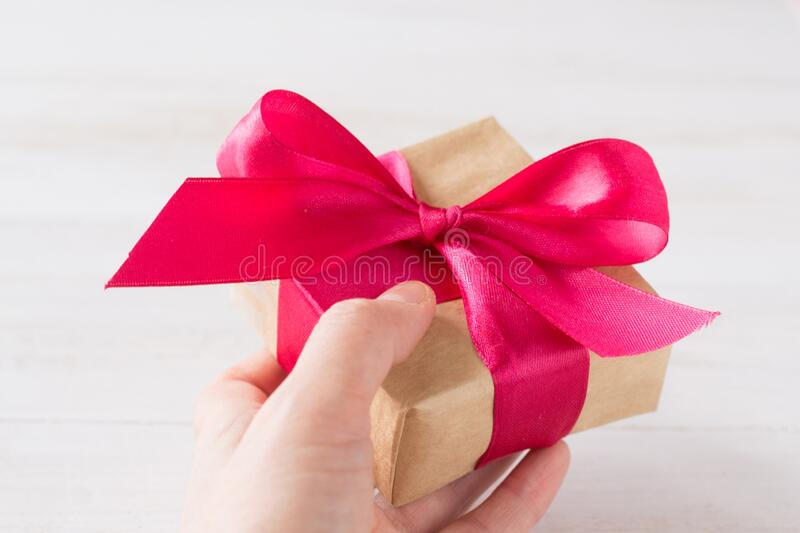 Gift craft paper box  with red bow stock images