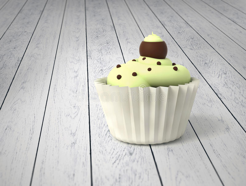 Gift cupcake with pistachio cream and chocolate balls on cold white wood royalty free stock images