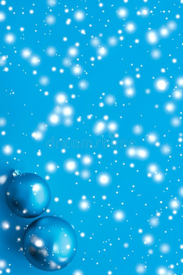 Christmas baubles on blue background with snow glitter, luxury winter holiday card. Gift decor, New Years Eve and happy celebration concept - Christmas baubles royalty free stock image
