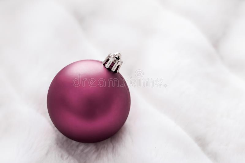 Purple Christmas baubles on white fluffy fur backdrop, luxury winter holiday design background. Gift decor, New Years Eve and happy celebration concept - Purple stock photos