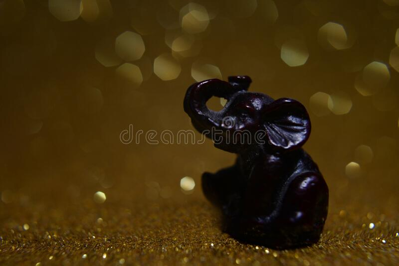 Gift elephant with trunk raised on blur background. For advertising or print on paper royalty free stock photo