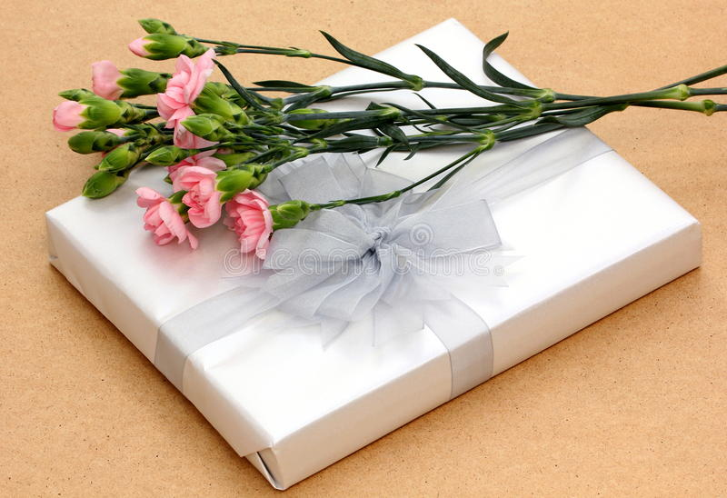 Gift and flowers stock image