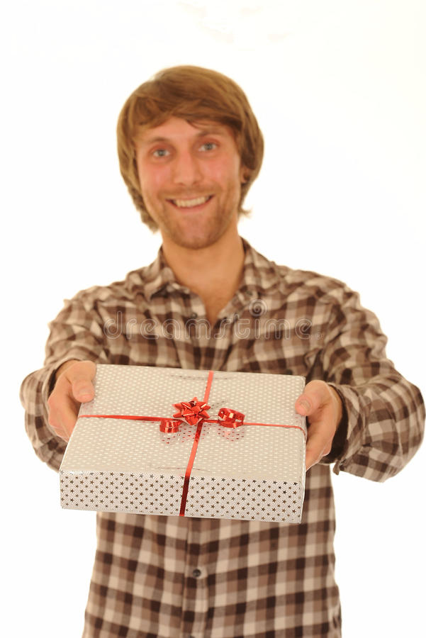 Gift Giving. Smiling man giving wrapped gift royalty free stock image