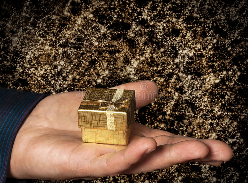 Gift in gold box royalty free stock photos