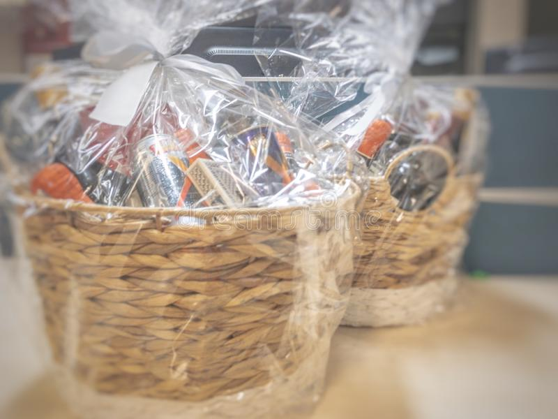 Gift hamper basket. Wrapped in plastic sheet sitting on a table ready for presentation royalty free stock photo