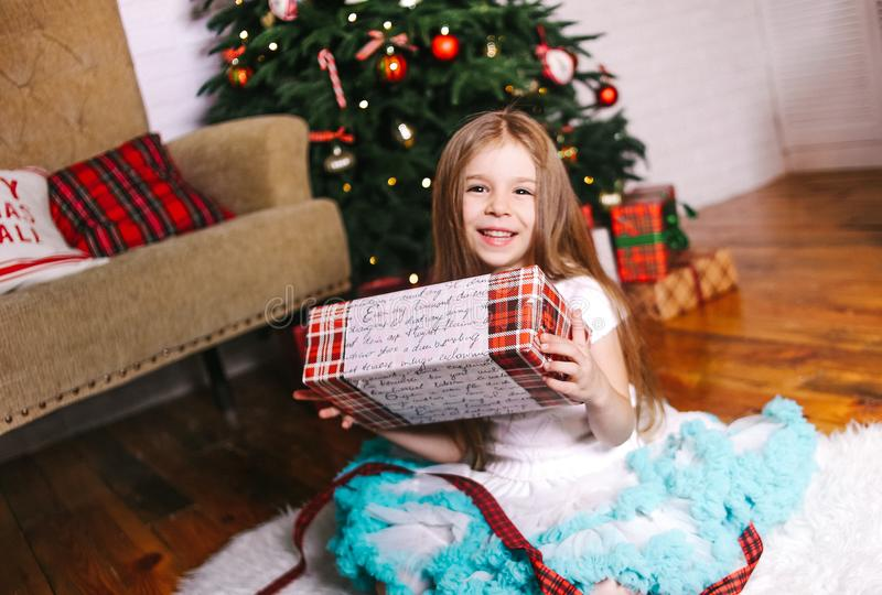 Gift hands girl Christmas tree emotions child stock photos