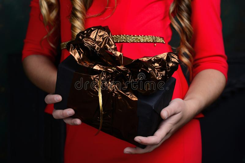 Gift in in the hands of a girl stock photo