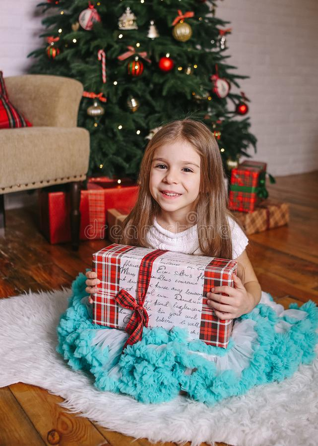 Gift hands girl Christmas tree emotions child stock image