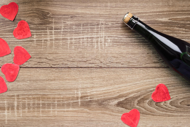 Gift , the heart and the bottle of red wine for a romantic holiday Valentine`s day stock images