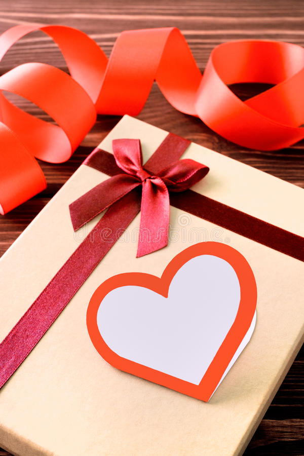 Gift with heart and ribbon stock photo