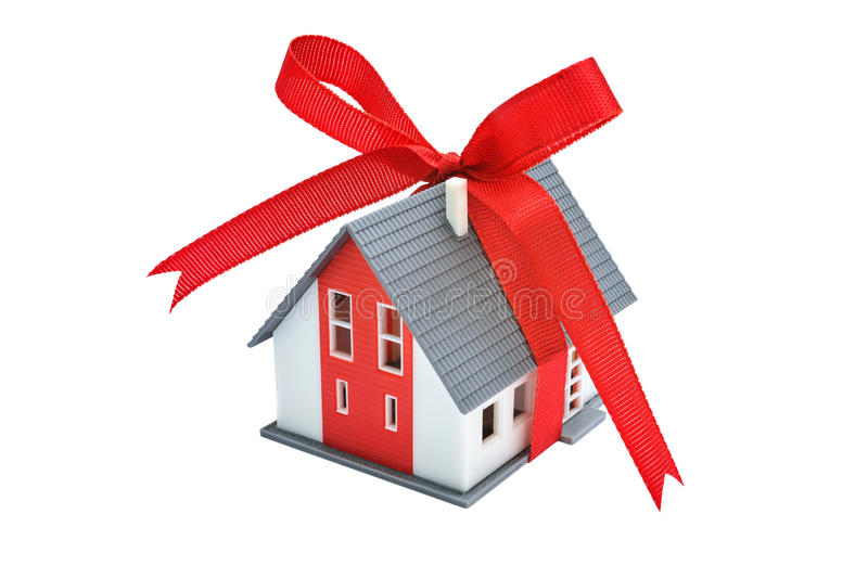 Gift house with red ribbon. Gift- house. Model of a house with red ribbon royalty free stock photography