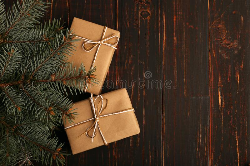 A gift from kraft paper, lies under Christmas tree. stock photo