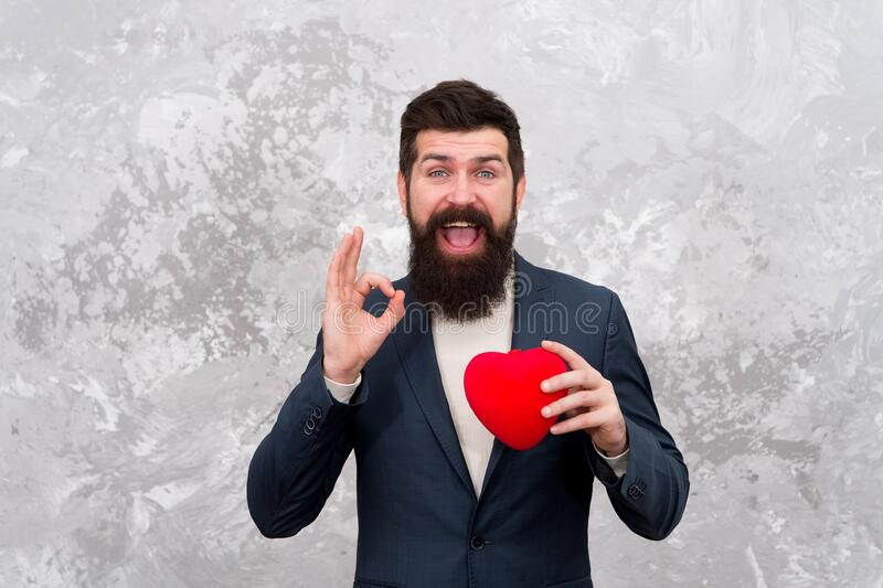 Gift of life. Hipster with red heart show ok sign. Gift for Valentines Day. Gift shop. Shopping for gift. Donate life stock photos