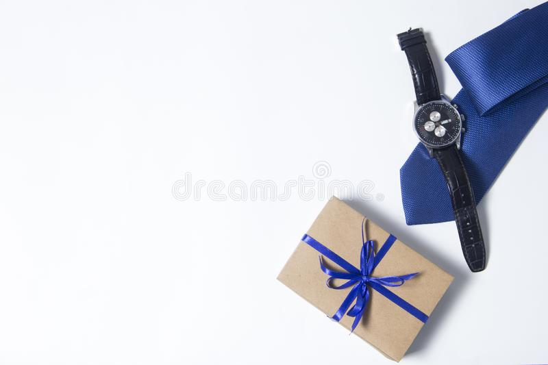 Gift for men. Mens accessories on white background. Beautiful small handmade DIY gift box royalty free stock images