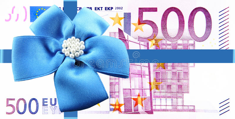 Gift of money. With a blue ribbon stock image