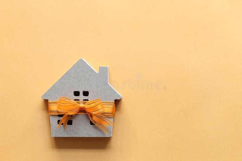 Gift new home and Real estate concept,Model house with Orange ribbon on colorful background stock images