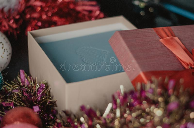 Gift packaging. Open christmas box with garland and balls royalty free stock photos