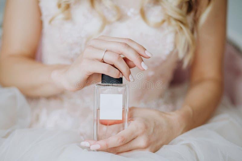 Gift perfume bottle female hands inscription free stock images