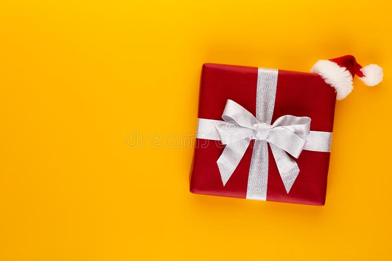 Christmas, holiday present box on red background royalty free stock photography