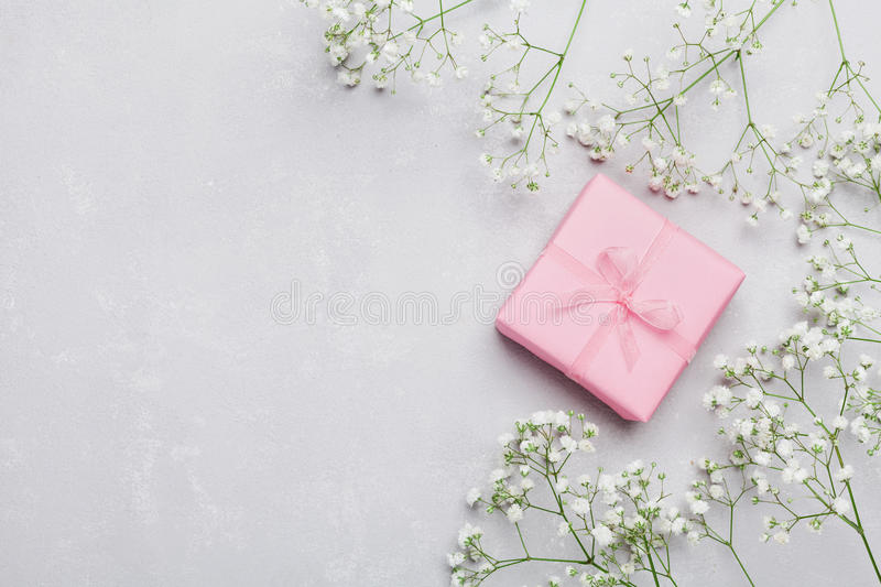 Gift or present box and flower on light table from above for Table 6 gift card