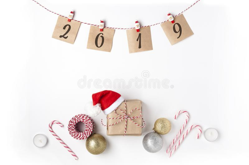 Gift in red hat santa claus, golden, silver balls, candles, notes royalty free stock image