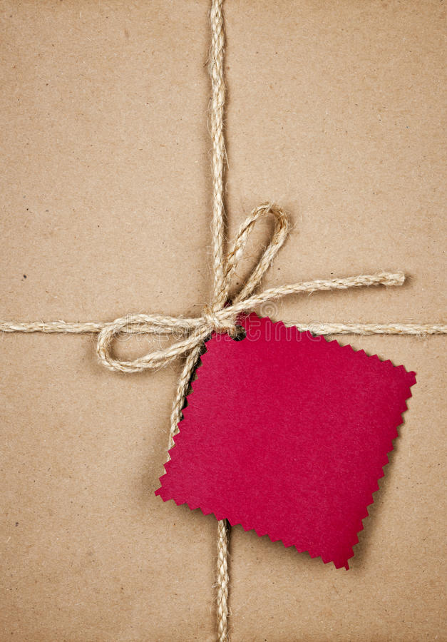 Download Gift With Red Tag In Brown Paper Stock Photo - Image: 28150926