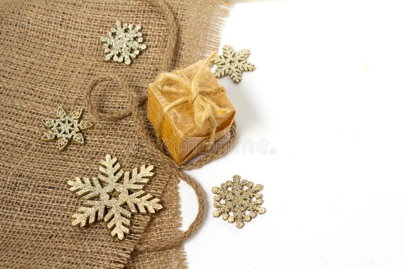 Gift in retro styles and christmas decorations isolated on white background. Christmas royalty free stock image