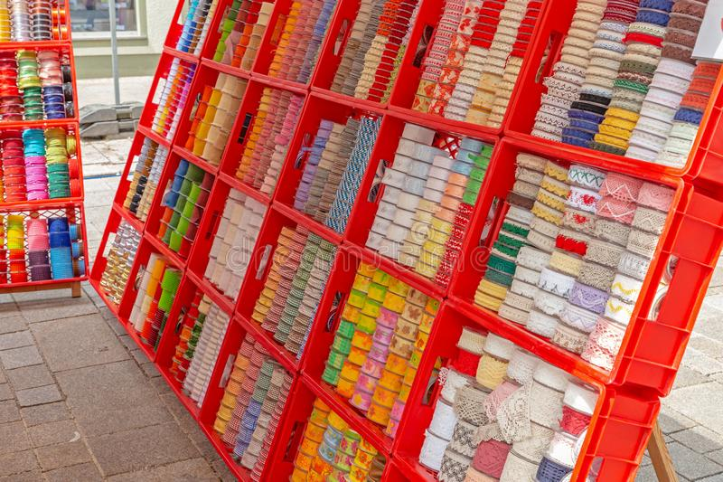 Gift ribbons and borders for sale at a market stall. In Germany stock images