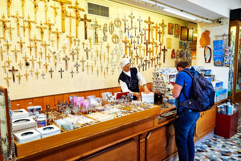 Gift shop in the Basilica of St. Peter in the Vatican. VATICAN CITY, VATICAN - OCTOBER 29: Gift shop in the Basilica of St. Peter in the Vatican, Rome, Italy on royalty free stock images