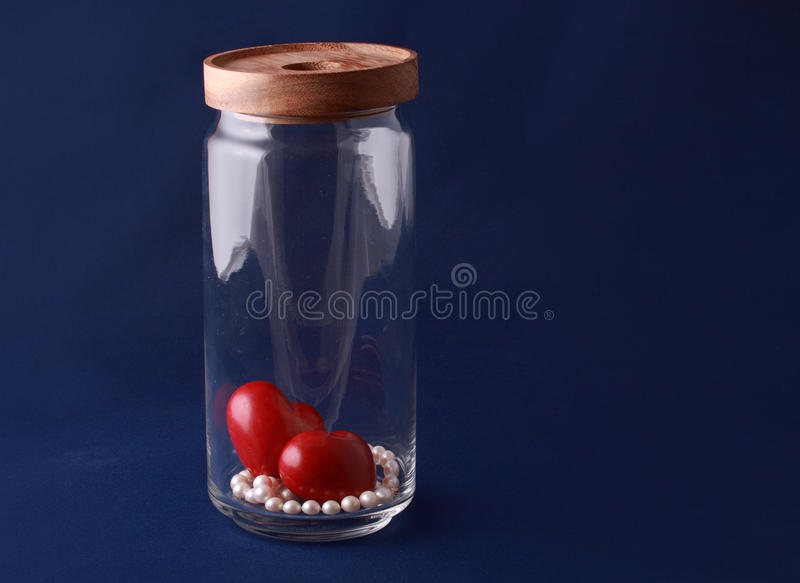Gift in a storage jar stock photos