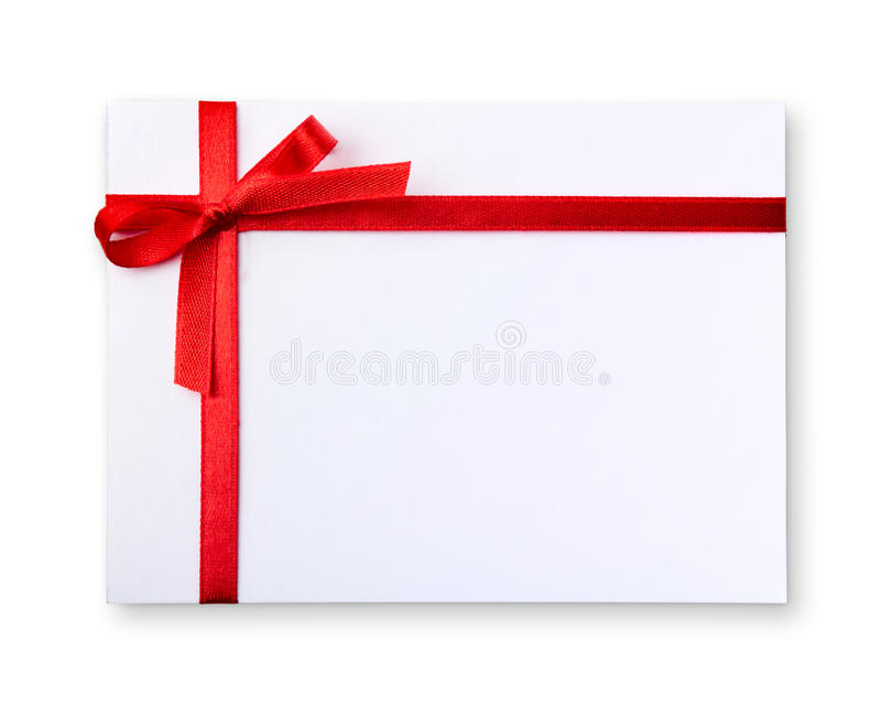 Gift tag. Blank gift tag tied with a bow of red satin ribbon royalty free stock images