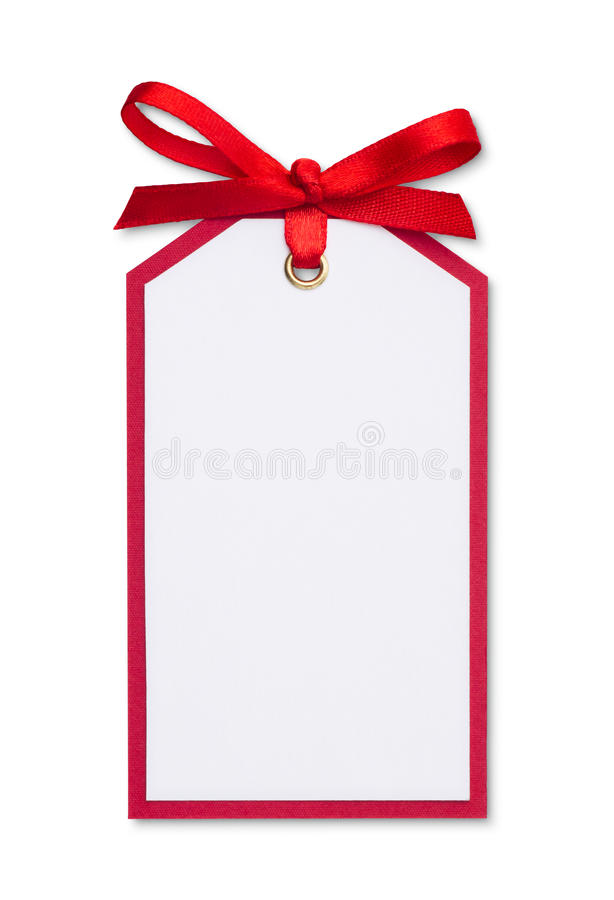 Gift tag. Blank gift tag tied with a bow of red satin ribbon stock photos