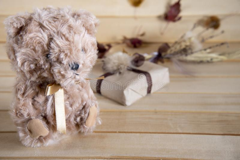 Gift and teddy bear on a wooden background. Autumn background with gifts. Cute gifts on a wooden background. stock photos
