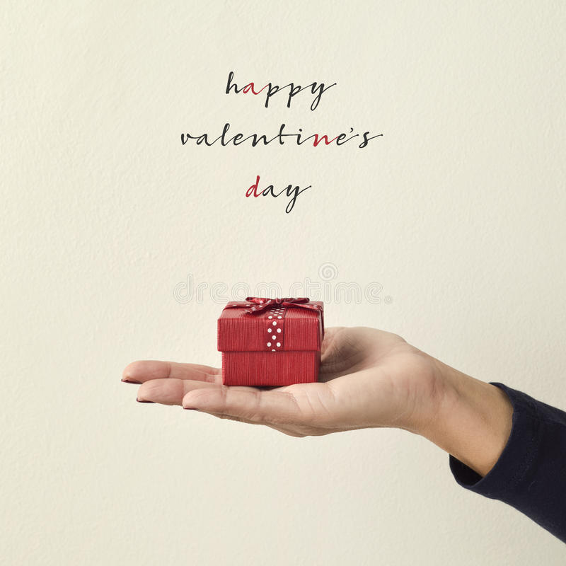Gift and text happy valentines day royalty free stock photo